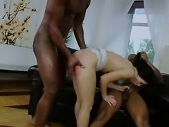Two monster black cock in her anus