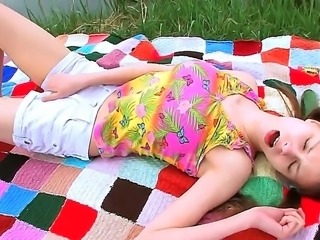 Sexy Beata outdoors gets naughty and horny fucks herself with a cucumber