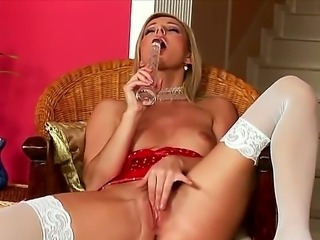Gorgeous blonde Vanessa is wearing her sexy white stockings and looks very nice and seducing! She takes her long sex toy and masturbates her shaved candy pussy.