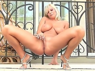 Adorable blonde Sheila Grant with big stunning knockers and long nails fingers her wet pussy