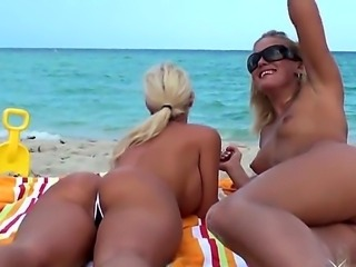Beautiful and sexy blondes Jc Simpson and Molly Cavalli love to tan topless at the public beach