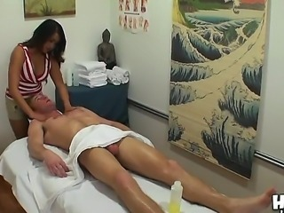Teen massage girl seduced her male client and started sucking his erected cock