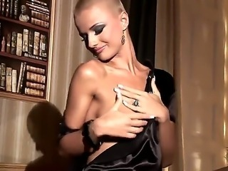 Fantastic girl with shaved head C.J. is showing her beautiful body on camera