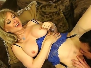 Nasty Nina Hartley demonstrates her big fuckable ass and plays with Daniel in adult games