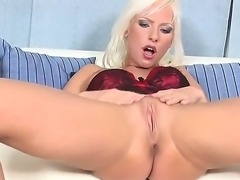 Blonde babe Alexis spreads her long legs and exposes her wet cunt starting to...