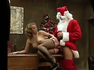Teenage blonde girl Kitty Cat is seduced to have sex by fellow in uniform of Santa. She is staying in black fishnet stockings before getting fat rod inside of mouth and cunt.