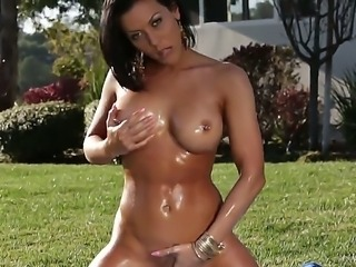 Sexy whore Rachel Starr showing her marvelous body and amazing big tits and being completely covered in oil is having a lot of fun masturbating her wet and horny pussy outdoors.