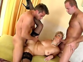 Beautiful blonde lady Luciana in super sexy stockings gets fucked by two guys! She enjoys two things: to suck and to feel a dick in her pussy, so this action is really pleasant for this babe.
