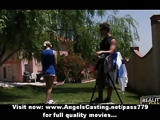 Gorgeous lovely blonde cheerleader training in the garden