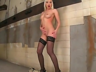 Sexy ass golden haired babe Lena Cova in black stockings and nothing else on...