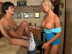 Amazing blonde babe is showing her huge titties on tape, while her sexy young...