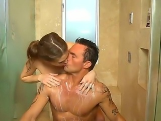 Muscular guy Marcus London stuffs horny mouth of his juicy female partner...
