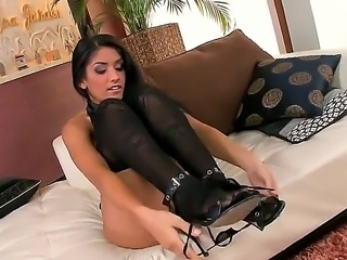 Sexy plump brunette babe Izabella De Cruz got on her bed in hot black blouse and sexy stockings and demonstrating tight bubble butt and naughty masturbation action!