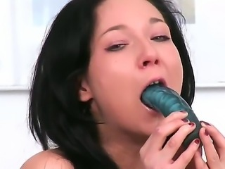 Brunette newcomer Anne Angel self-penetrates her fresh asshole with a new dildo