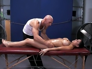 Johnny Sins makes superb massage to his client. The man likes touching and...