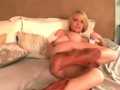 Lovely babe Krissy Lynn enjoys rubbing her cunt very deep and hard in wild solo