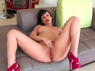 Appetizing and gorgeous pale skinned Jennifer White with big natural boobs plays with her shaved pussy