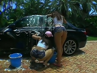 Micah Moore and Pinky are the best and the sexiest car wash girls weve ever seen. Their clothes come off in few moments after they begin to lather up the car and their mind blowing butts.
