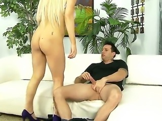 Blonde Nikki Phoenix enjoys sitting on her knees and sucking on huge dicks