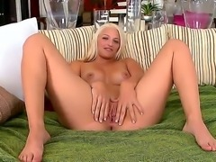 Hot blonde in tiny swiming suit showing off her big ass and shaved cunt by...