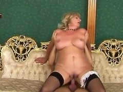 Blonde woman in age is screwing with dude. She stays in stockings and high...