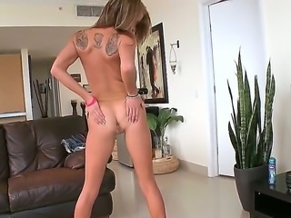 Blond babe is stripping for money and revealing her perky boobs, shaved pussy...