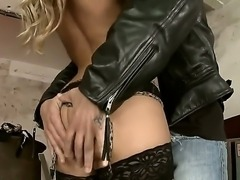 Sexy tattooed chick Barbie White in fishnet stockings is giving hunk a lusty...