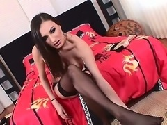 The hottest brunette pornstar Louise Black in a black stockings shows her...