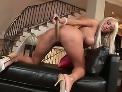 Busty blonde Lachelle ravages her tight wet pussy by pounding it with a stiff...
