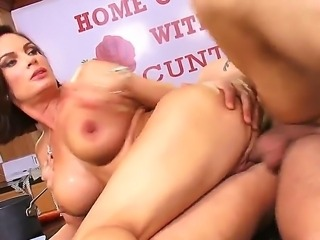 Dark haired lusty milf Diamond Foxxx with long red nails and big juicy knockers gets nailed hard from behind by Mr. Pete to loud and wet orgasms in the kitchen.