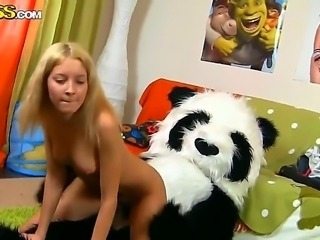 Blonde slut Sveta feels horny at her home and she attacks her lovely big panda toy and fucks its dildo dong