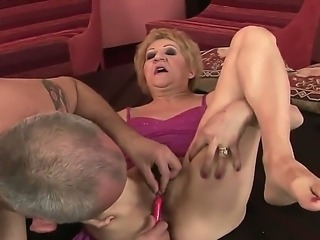 Perverted man is bringing this old woman Kati Bell at cloud seven from delight using different kinds of sex toys. He pushes dildos into her holes  stimulates clit by vibrator.