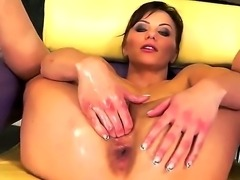 Brunette girl Alysa Gap oils her dark pussy and shoves her palm deep in it