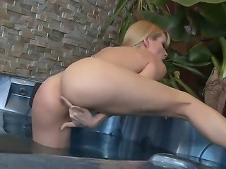 Long haired glamorous blonde babe Sophie Moone with dark heavy make up and slim sexy body spreads long legs and fingers her hairless cunny to warm orgasmic feeling in jacuzzi.