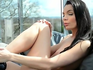 Arousing and sensual brunette Kyla Fox strips and does her amazing solo act on the couch