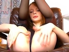 Teen pale-bodied chick Gloria pushes aside her panties and poses on the...