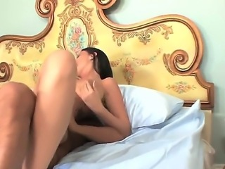 Turned on experienced black haired milf Bella Blaze with hanging juicy knockers and big ass seduces young handsome stud and makes him cum on her belly in bedroom fantasy.