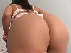 Franceska Jaimes is busy with fine demonstration of her body forms. Her white...