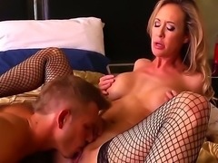Gorgeous big tited milf Brandi Love takes off her bra and sucks Bill Baileys...