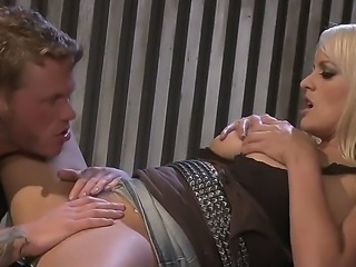 Very hot blonde with big boobs is giving blowjob and getting fucked by a biker sitting on his bike