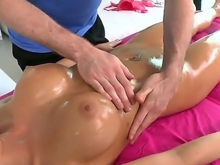 Steaming hot blonde porn star Rikki Six wtih huge firm balloons gets her shaved innie muff oiled and masaged