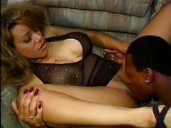 Busty black chick sucked by man