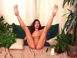 Cassie Laine takes out the lotion and moisturizers her supple body. Babe spreads her legs without shame and shows her shaved pussy on the camera.