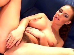The gorgeous hot brunette masturbates her hairy beautiful pussy and sucks her...