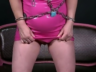 Our blonde babe from the U.K. Angel Deelight is back, and this time shes a little bit pissy! She comes to us in a shiny pink outfit and all wrapped up in chains when suddenly nature calls!