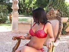 Seductive brilliant brunette wearing red lingerie likes to have a dildo in...