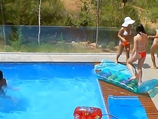 Five naughty lesbians, Adria, Leo, Lily, Megana and Mia, have real fun in the swimming pool teasing each other