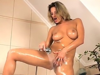 Amazingly hot masturbation scene from Carolyn Cage would make you aroused. The diva with cool body becomes wet in a shower before taking dildo and starting to push it in twat.