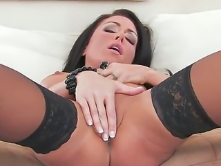 Black-haired dodger Jessica Jaymes puts on sexy stockings and fingers her hot beaver intensively. The moist runs fast very quickly as she starts masturbating.