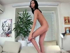 Skinny brunette bitch Alaine takes off her sexy clothes and masturbates